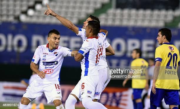 Paraguayan Nacional footballer Rodrigo Teixeia celebrates after scoring against Chilean Universidad de Concepcion during their Copa Sudamericana...