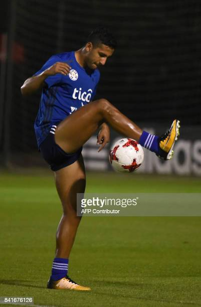 Paraguayan national football team player Cecilio Dominguez controls the ball during a training session at the Complejo Albiroga training centre in...