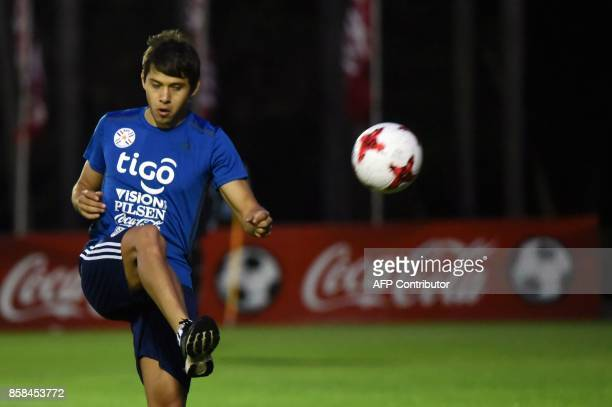 Paraguayan national football team player Oscar Romero takes part in a training session at the Complejo Albiroga training centre in Ypane near...