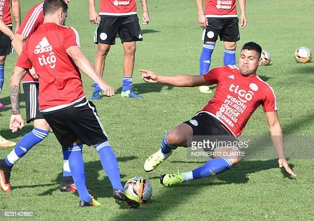 Paraguayan national football team players Juan Patino and Oscar Romero take part in a training session at the Complejo Albiroga training centre in...