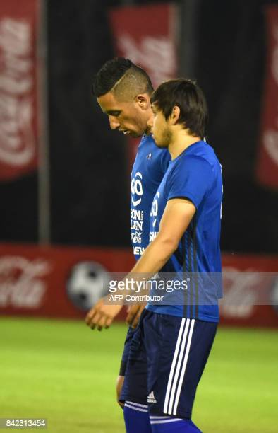 Paraguayan national football team players Lucas Barrios and Oscar Romero take part in a training session at the Complejo Albiroga training centre in...