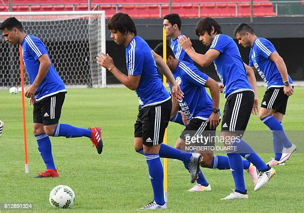 Paraguayan national football team players Oscar Romero and Angel Romero take part in a training session at Defensores Del Chaco Stadiom in Asuncion...