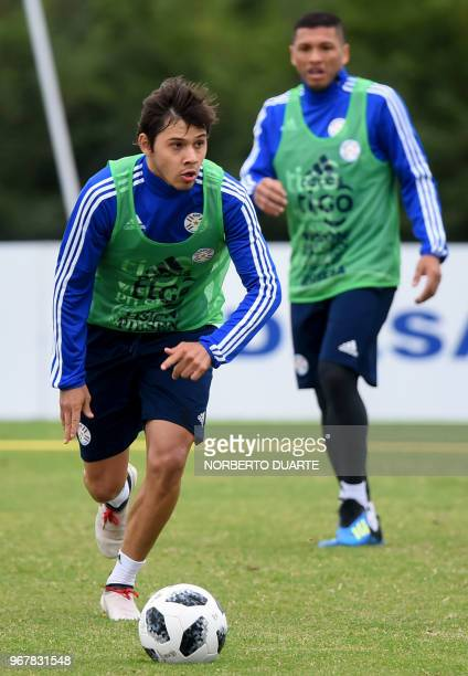 Paraguayan national football team players Oscar Romero and Richard Ortiz take part in a training session at Albiroga training center in Ypane...