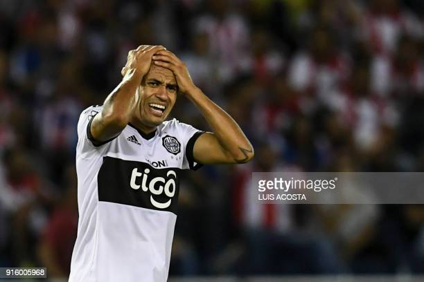 Paraguayan Olimpia defender Colombian Sergio Otalvaro reacts during their Copa Libertadores football match against Paraguay's Olimpia at Roberto...