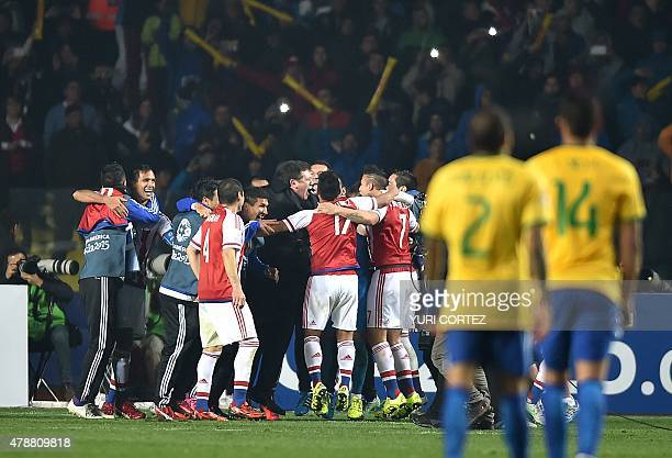 Paraguayan player celebrate after winning in their 2015 Copa America football championship quarterfinal match against Brazil in Concepcion Chile on...