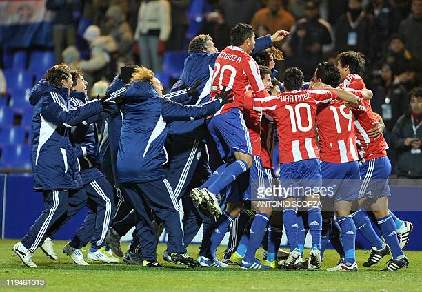 Paraguayan players celebrate after beating Venezuela in shootouts in their 2011 Copa America semifinal football match held at the Malvinas Argentinas...