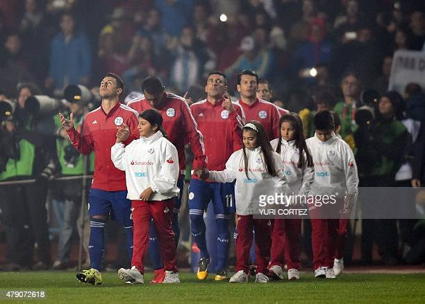 Paraguayan players enter the field before their Copa America semifinal football match against Argentina in Concepcion, Chile on June 30, 2015. AFP...