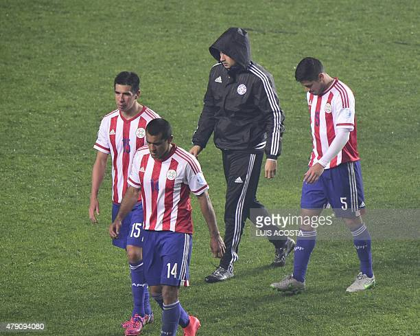 Paraguayan players leave in dejection after their Copa America semifinal football match against Argentina in Concepcion Chile on June 30 2015...