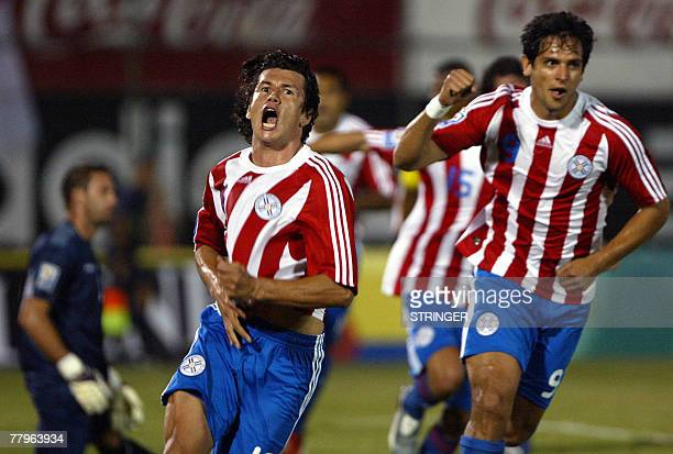 Paraguayan players Nelson Haedo celebrates next to Roque Santa Cruz after scoring against Ecuador during their FIFA World Cup South Africa2010...