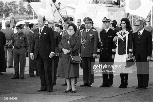 Paraguayan President Alfredo Stroessner and his wife wait for the arrival of Japanese Crown Prince Akihito and Crown Princess Michiko at Asuncion...