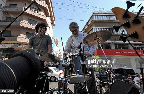 Paraguayan President Fernando Lugo messes around on a drumset at a ceremony commemorating the first anniversary of his administration in office in...