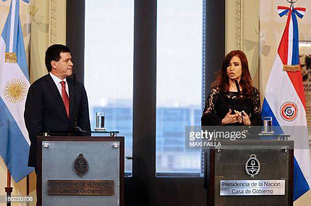 Paraguayan President Horacio Cartes and Argentine President Cristina Fernandez de Kirchner deliver a joint press conference at the Government Palace...