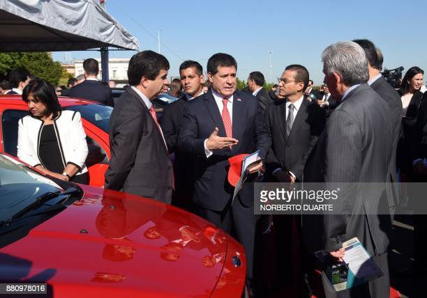 Paraguayan President Horacio Cartes and Brazilian Industry Foreign Trade and Services Minister Marcos Pereira attend the official presentation of the...