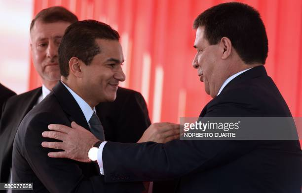 Paraguayan President Horacio Cartes greets Brazilian Industry Foreign Trade and Services Minister Marcos Pereira during the official presentation of...