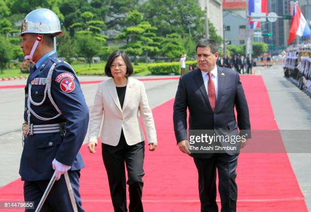 Paraguayan President Horacio Cartes reviews the honour guard with Taiwanese President Tsai Ingwen during the welcome ceremony on July 12 2017 in...