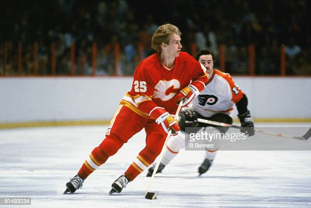 Paraguayan professional hockey player Willi Plett of the Calgary Flames skates without a helmet on the ice in a game against the Philadelphia Flyers...