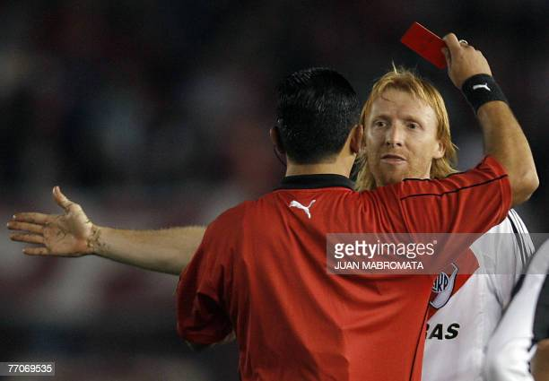 Paraguayan referee Carlos Amarilla shows the red card to defender Federico Lussenhoff of Argentina's River Plate during the Copa Sudamericana 2007...