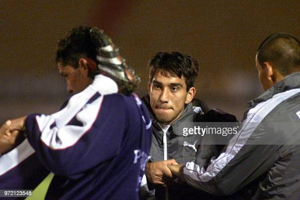 Paraguayan soccer players Nelson Cuevas and Roberto Acuna strech 27 March 2001 in the Centenario Stadium in Montevideo Uruguay El paraguayo Nelson...