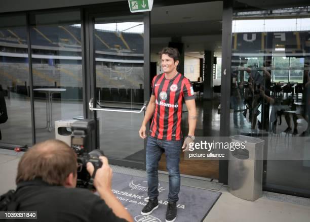 Paraguayan striker Nelson Valdez wears an Eintracht jersey after his presentation as new player of Bundesliga soccer club Eintracht Frankfurt at...