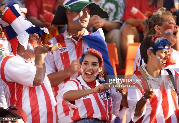 Paraguayan supporters play music and dance 19 June at Geoffroy Guichard stadium in SaintEtienne central France before the 1998 Soccer World Cup Group...