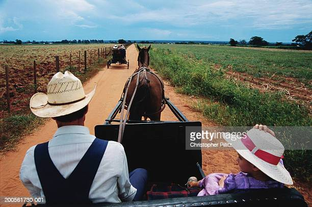 Paraguay,Rio Verde,Mennonite man and daughter riding horse drawn wagon