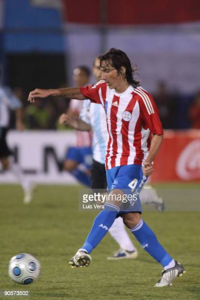 Paraguay's Aureliano Torres conducts the ball against Argentina during their 2010 FIFA World Cup qualifier at the Defensores del Chaco Stadium on...