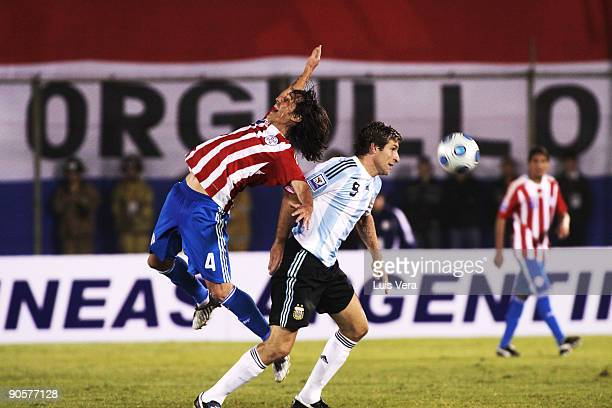 Paraguay's Aureliano Torres vies for the ball with Martin Palermo of Argentina during their 2010 FIFA World Cup qualifier at the Defensores del Chaco...