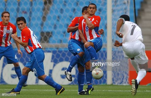 Paraguay's Carlos Gamarra Roberto Acuna Roque Santa Cruz Guido Alvarenga protect themselves as South African Quinton Fortune gets ready to shoot the...