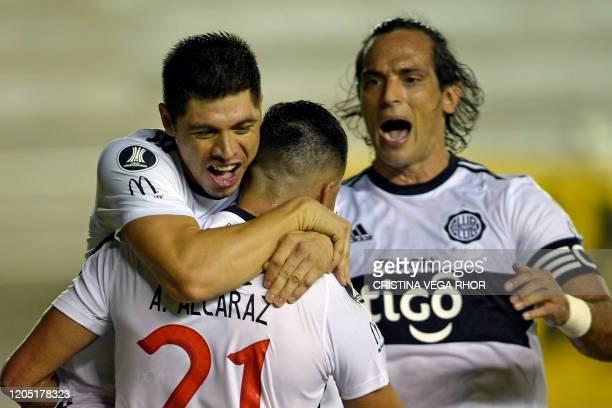 Paraguay's Club Olimpia player Antolin Alcaraz celebrates after scoring a goal during the Copa Libertadores football match against Ecuador's Delfin...