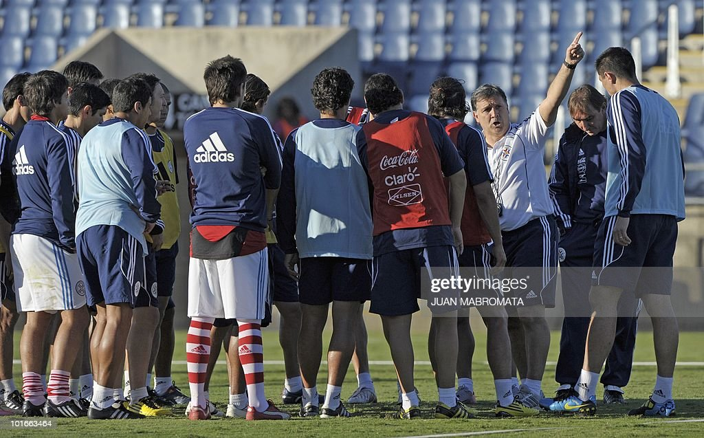 Paraguay's coach Gerardo Martino (3rd-R) gives instructions to his team during a training session at Harry Gwala stadium in Pietermaritzburg on June 6, 2010 ahead of the 2010 World Cup in South Africa.