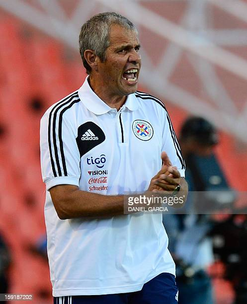 Paraguay's coach Victor Genes gives instructions to his players during their South American U-20 Championship Group A football match against...