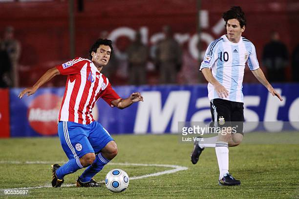 Paraguay's Cristian Riveros vies for the ball with Martin Palermo of Argentina during their 2010 FIFA World Cup qualifier at the Defensores del Chaco...