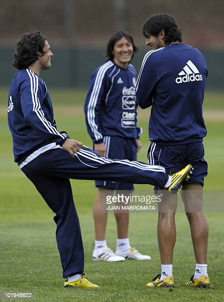 Paraguay's defender Aureliano Torres looks at forward Nelson Haedo as he jokes with forward Roque Santa Cruz during a training session at...
