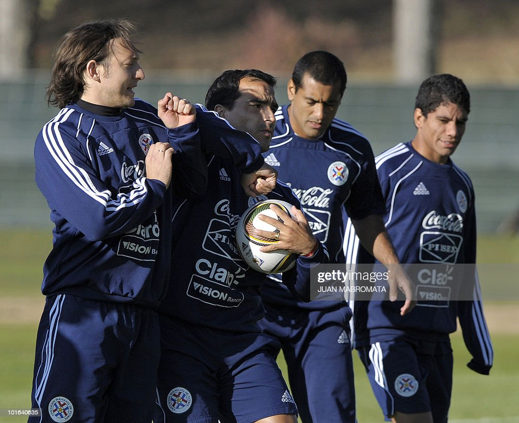 Paraguay's defender Claudio Morel Rodriguez (2nd L) fights for the ball with midfielder Edgar Barreto (L), next to defender Paulo Da Silva and forward Rodolfo Gamarra (R), during a training session at Michaelhouse school in Balgowan on June 5, 2010. Pararguay faces Italy on June 14 in Cape Town for their Group F football match in the 2010 World Cup football tournament.