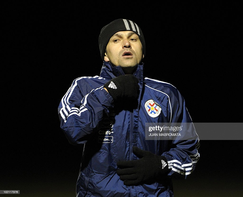 Paraguay's defender Denis Caniza wraps up in the cold weather during a training session at Michaelhouse school in Balgowan on June 15, 2010 a day after their first match against Italy ended 1-1 and ahead their second 2010 World Cup Group F football match against Slovakia on June 20 at Free State stadium in Bloemfonstein.