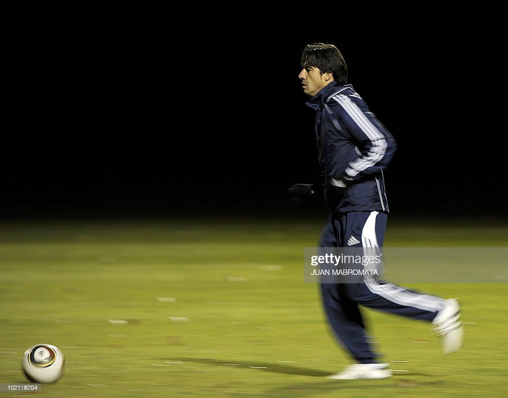 Paraguay's defender Julio Cesar Caceres jogs with a ball during a training session at Michaelhouse school in Balgowan on June 15, 2010. The 2010 World Cup hosted by South Africa continues through July 11.