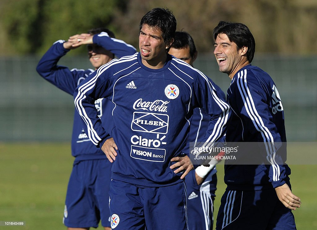 Paraguay's defender Julio Cesar Caceres (R) smiles next to midfielder Victor Caceres (C) during a team training session at Michaelhouse school in Balgowan on June 5, 2010. Pararguay faces Italy on June 14 in Cape Town for their Group F football match in the 2010 World Cup football tournament.
