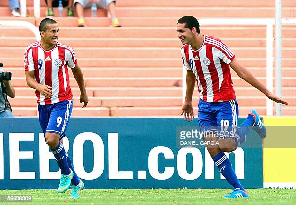Paraguay's defender Matias Perez celebrates with teammate forward Cecilio Dominguez after scoring against Bolivia during their South American U20...