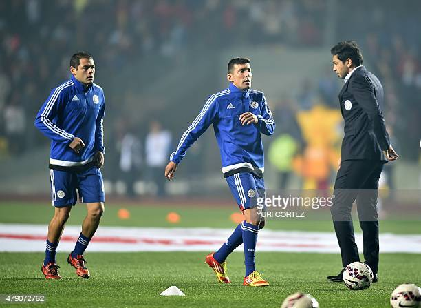 Paraguay's defender Pablo Cesar Aguilar and Paraguay's forward Edgar Benitez warm up before their Copa America semifinal football match against...