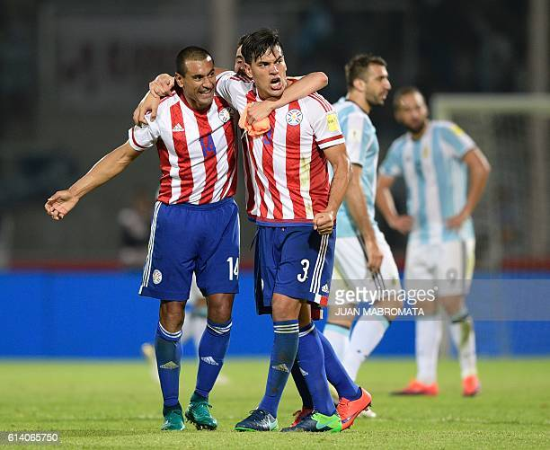 Paraguay's defender Paulo Da Silva and Paraguay's Gustavo Gomez celebrate their 01 team victory against Argentina at the end of their Russia 2018...