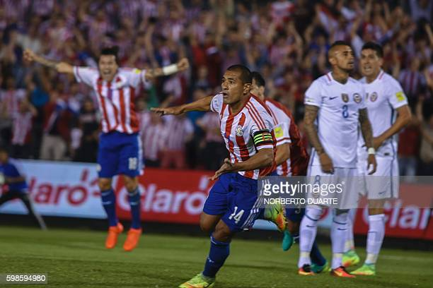 Paraguay's defender Paulo Da Silva celebrates after scoring against Chile during the FIFA World Cup 2018 qualifier football match between Paraguay...