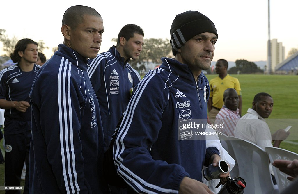 Paraguay's defenders Denis Caniza (R), Dario Veron (2nd-L), Antolin Alcaraz (C-back) and forward Nelson Haedo (L) wait to pose for a group picture at the end of a training session at Harry Gwala stadium in Pietermaritzburg on June 6, 2010 ahead of the 2010 World Cup in South Africa.