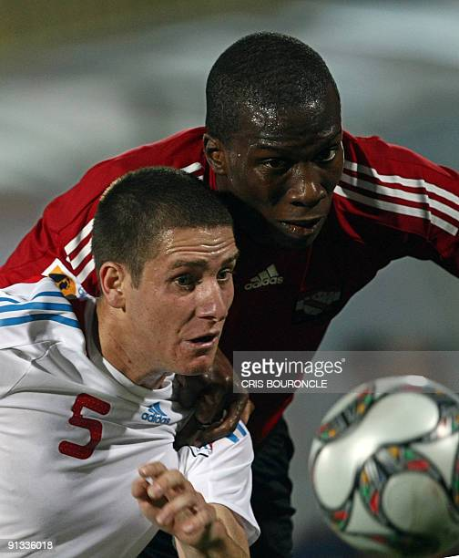 Paraguay�s defense Francisco Silva and Trinidad�s forward Jamaal Gay vie for the ball during the second half of the game played between Trinidad and...