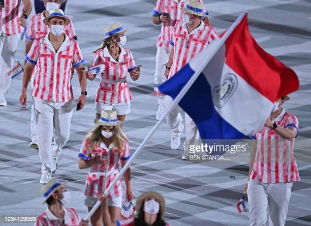Paraguay's delegation parade during the opening ceremony of the Tokyo 2020 Olympic Games, at the Olympic Stadium, in Tokyo, on July 23, 2021.