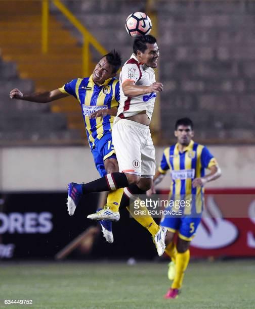 Paraguays Deportivo Capiata Alexis Gonzalez and Peru's Universitario Hernan Rengifo vie for the ball in the firstround Copa Libertadores football...