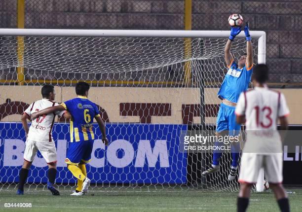 Paraguays Deportivo Capiata goalie Bernardo Medina jumps for the ball in the firstround Copa Libertadores football match against Perus Universitario...