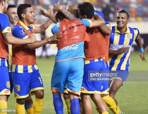 Paraguays Deportivo Capiata Jorge Rodriguez and teammates celebrate his goal against Peru's Universitario during their firstround Copa Libertadores...