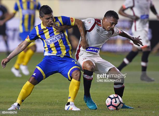 Paraguays Deportivo Capiata player Alexis Gonzalez and Perus Universitario player Arquimedes Figuera vie for the ball in the firstround Copa...