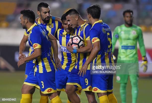 Paraguays Deportivo Capiata player Roberto Gamarra celebrates with teammates after scoring against Perus Universitario during their Copa Libertadores...