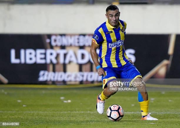 Paraguays Deportivo Capiata player Roberto Gamarra shoots to score against Perus Universitario in their firstround Copa Libertadores football match...